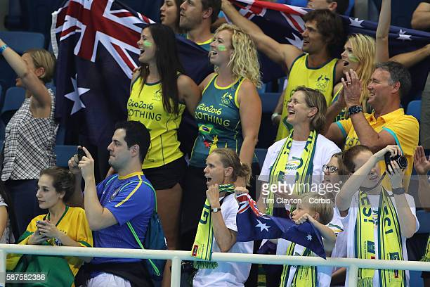 Day 1 Australian supporters cheer for Emma McKeon Brittany Elmslie Bronte Campbell and Cate Campbell at the medal presentation for winning the gold...