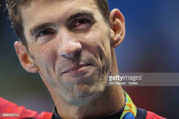 Day 4 Michael Phelps of the United States sheds a tear as he parades with his gold medal after winning the Men's 200m Butterfly Final during the...