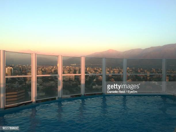 swimming pool against city - danielle reid stock pictures, royalty-free photos & images