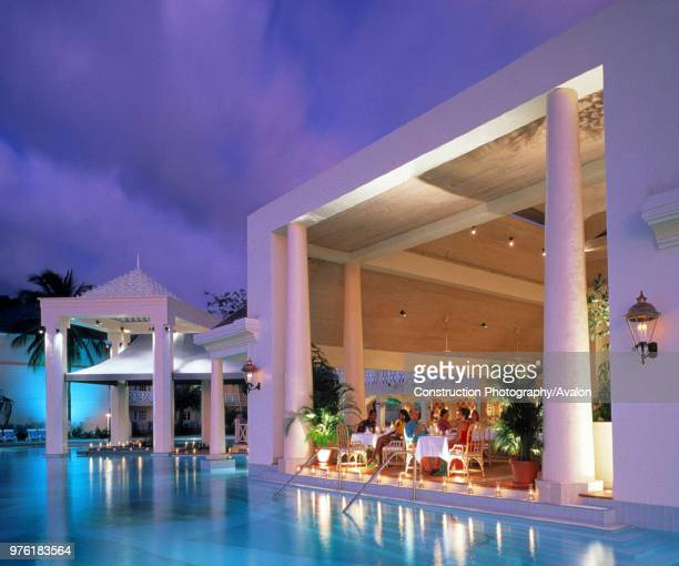 Swimming pool and dining room of hotel Sandals at evening island of Saint Lucia archipelago of the Lesser Antilles Caribbean