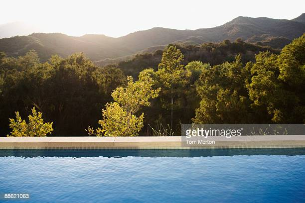 swimming pool and distant hills - calabasas stock pictures, royalty-free photos & images