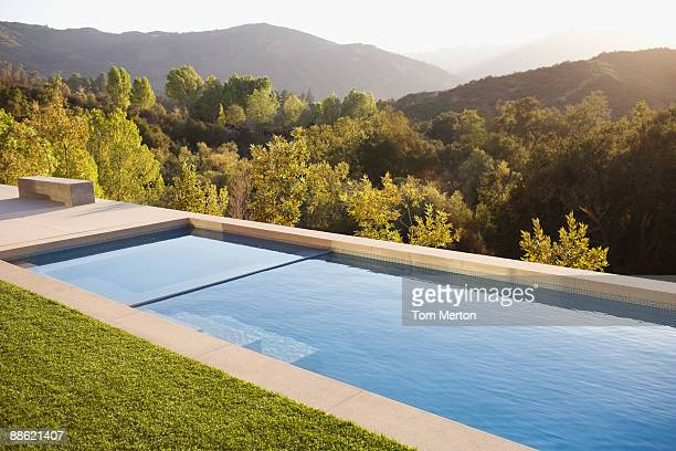 swimming pool and distant hills - calabasas stock photos and pictures