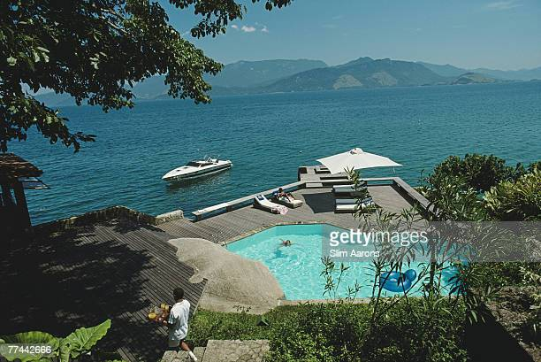 A swimming pool and lounge deck over the sea at Angra Dos Reis Brazil 1985