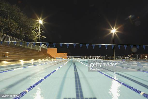 swimming pool at night - length stock pictures, royalty-free photos & images
