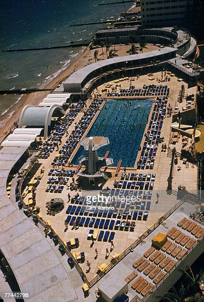 A swimming pool at the Fontainebleau Hotel Miami circa 1955