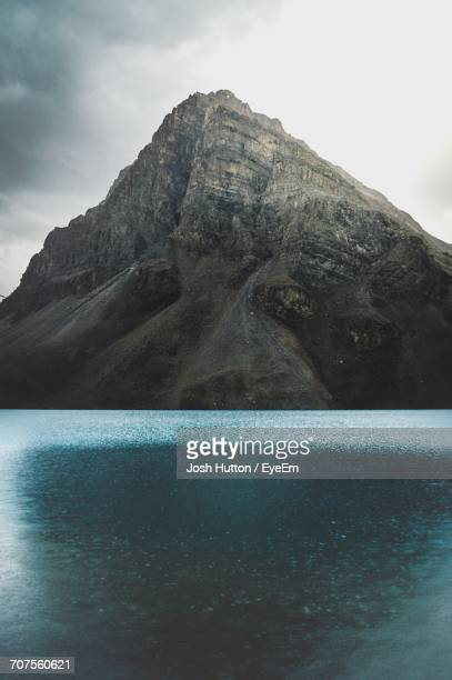 swimming pool by mountain against sky - hutton stock photos and pictures
