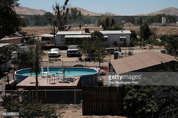 A swimming pool contrasts with the drought dried landscape in East Porterville CA on July 17 2015 The owner Tasha Smith said that the pool has been...