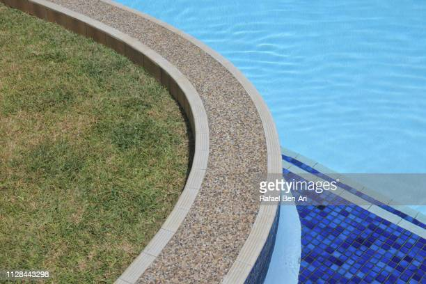 swimming pool edge - rafael ben ari stock pictures, royalty-free photos & images