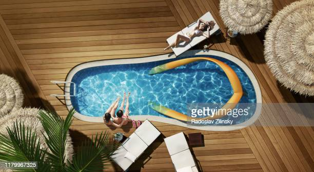 swimming pool in a shape of flip flop - ビーチサンダル ストックフォトと画像