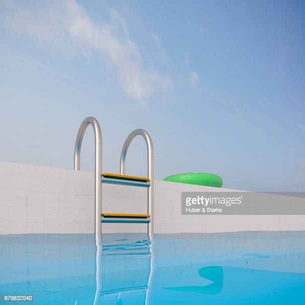swimming pool, ladder and floating tire - ruhige szene stock pictures, royalty-free photos & images