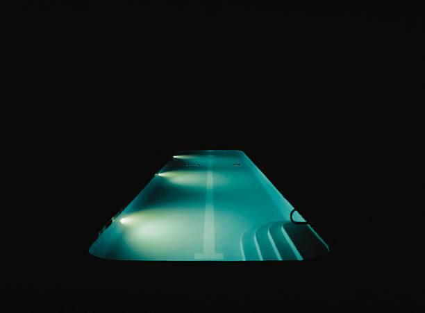 A swimming pool lit at night