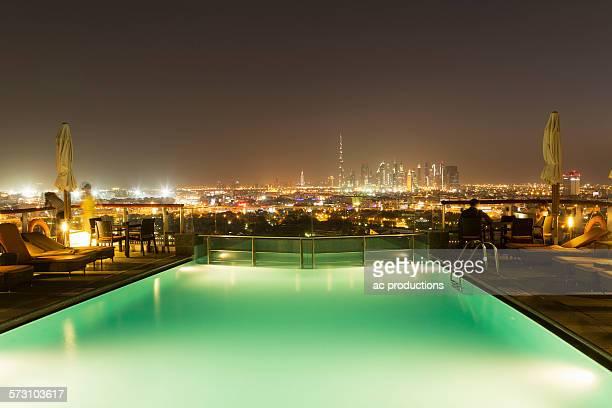 Swimming pool over cityscape at night, Abu Dhabi Emirate, United Arab Emirates