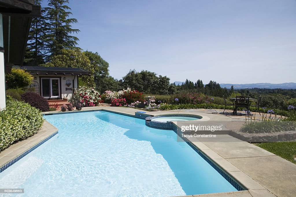 Swimming pool overlooking rural landscape : Stock Photo