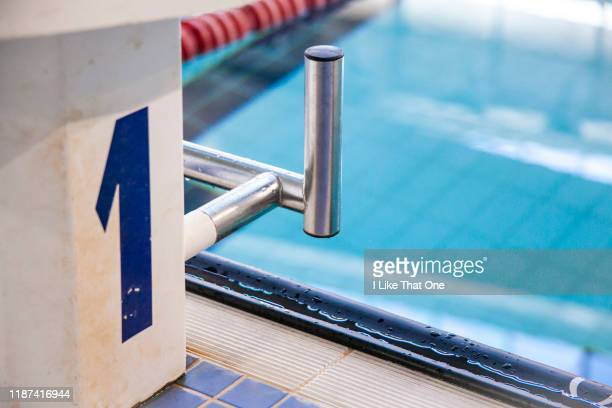 swimming pool starting block - atomic imagery stock photos and pictures
