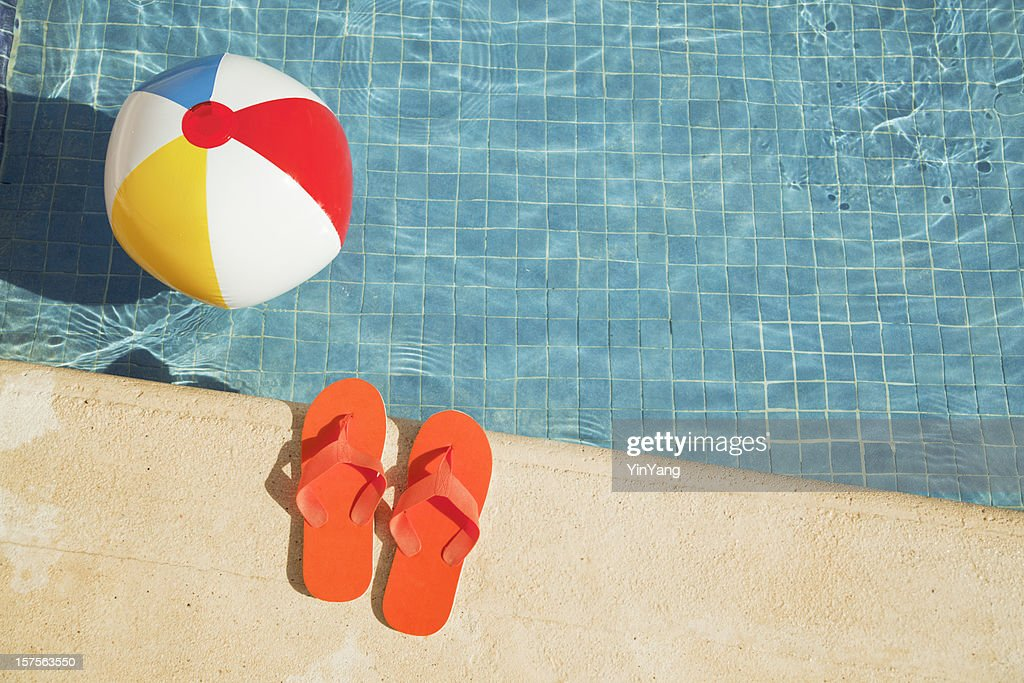 beach ball on beach. Swimming Pool Summer Vacation Fun With Floating Beach Ball, Sandals Ball On