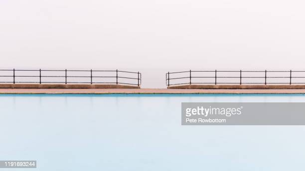 swimming pool symmetry - llandudno wales stock pictures, royalty-free photos & images