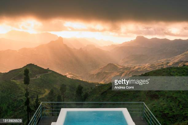 swimming pool with view over grand canary caldera with roque bentayga at sunset. grand canary, canary islands - tejeda canary islands stock pictures, royalty-free photos & images