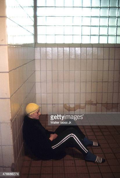 Portrait of East Germany Kornelia Ender seated in locker room during photo shoot East Germany 6/7/1976 CREDIT Walter Iooss Jr
