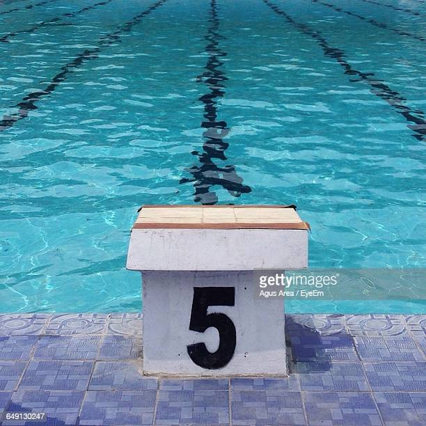 swimming starting block number 5 against pool - number 5 stock pictures, royalty-free photos & images