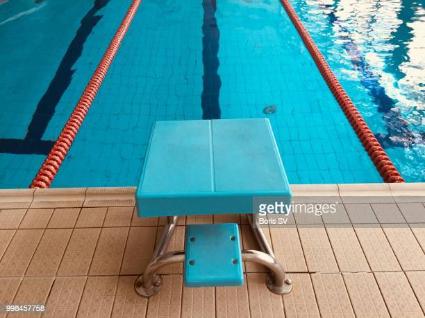 swimming starting block - length stock pictures, royalty-free photos & images