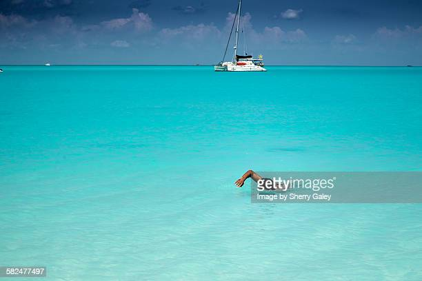 swimming to shore - abaco islands stock pictures, royalty-free photos & images