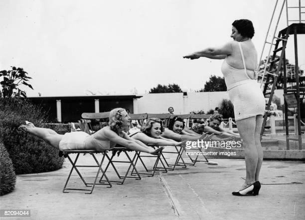 Swimming training ashore A trainer is showing how to swim Photograph August 29th 1938 [Schwimmtraining an Land Eine Ausbildnerin zeigt ihren Schlern...