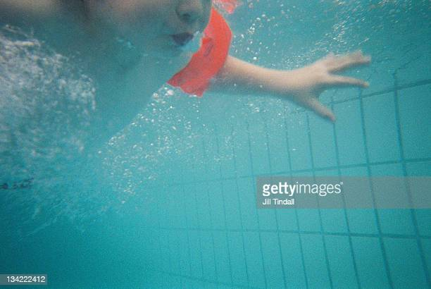 Swimming underwater in pool on holiday