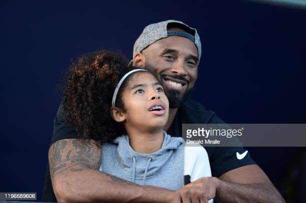 US National Championships Closeup of former basketball player Kobe Bryant with daughter Gianna watching action at William Woollett Jr Aquatics Center...
