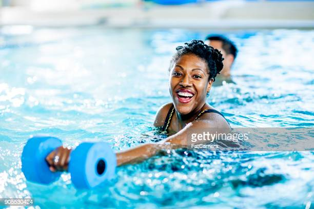swimming with weights - adult stock pictures, royalty-free photos & images