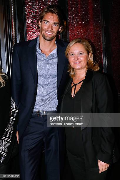 Swimming world champion Camille Lacourt and Director of public relations of Clarins Isabele Fromager attend 'AClub Party' at Castel on September 19...
