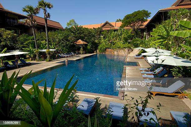Swimming-pool at a plush resort in the tourist laden city of Siem Reap, near the famed Angkor temples in Cambodia. .