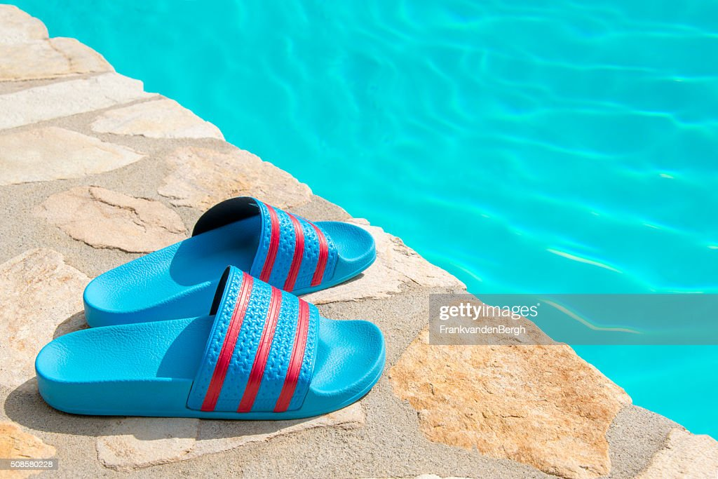 Swimmingpool with slippers : Stock Photo