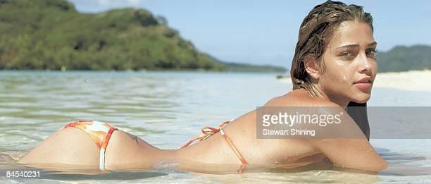 HUAHINE ITI PF Swimsuit 2006 Issue Portrait of Ana Beatriz Barros lying in water at Te Tiare Beach Resort Bikini by Letarte by Lisa Cabrinha