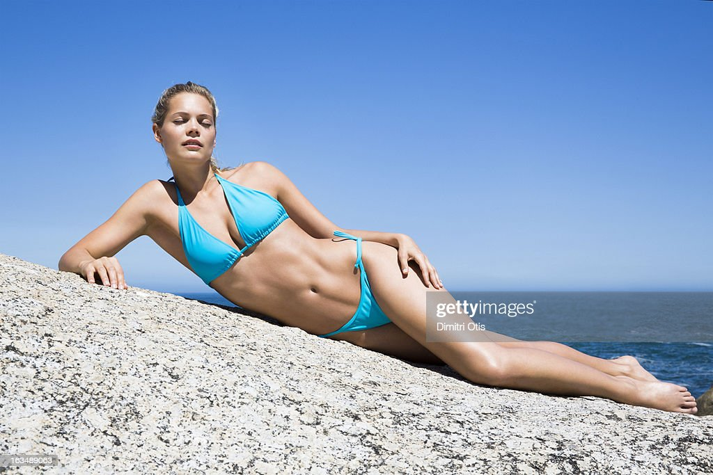 Swimsuit beauty in the sun with blue sky : Stock Photo