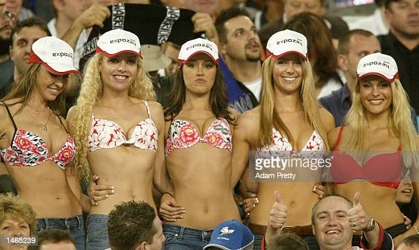 Swimsuit fans including Jennifer Hawkins of Australia show their wares during the 2002 NRL Grand Final played between the Sydney Roosters and the New...