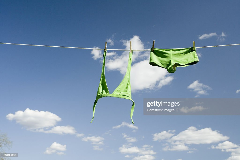 Swimsuit hanging on clothesline : Stockfoto