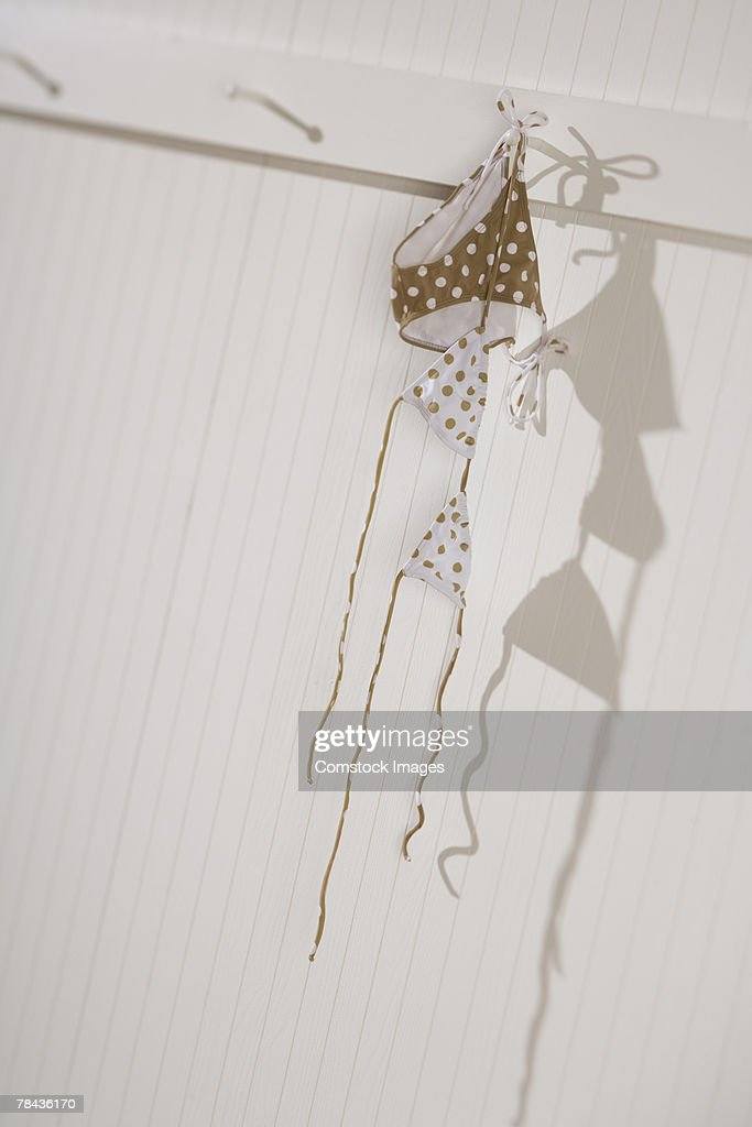 Swimsuit hanging on hook : Stockfoto