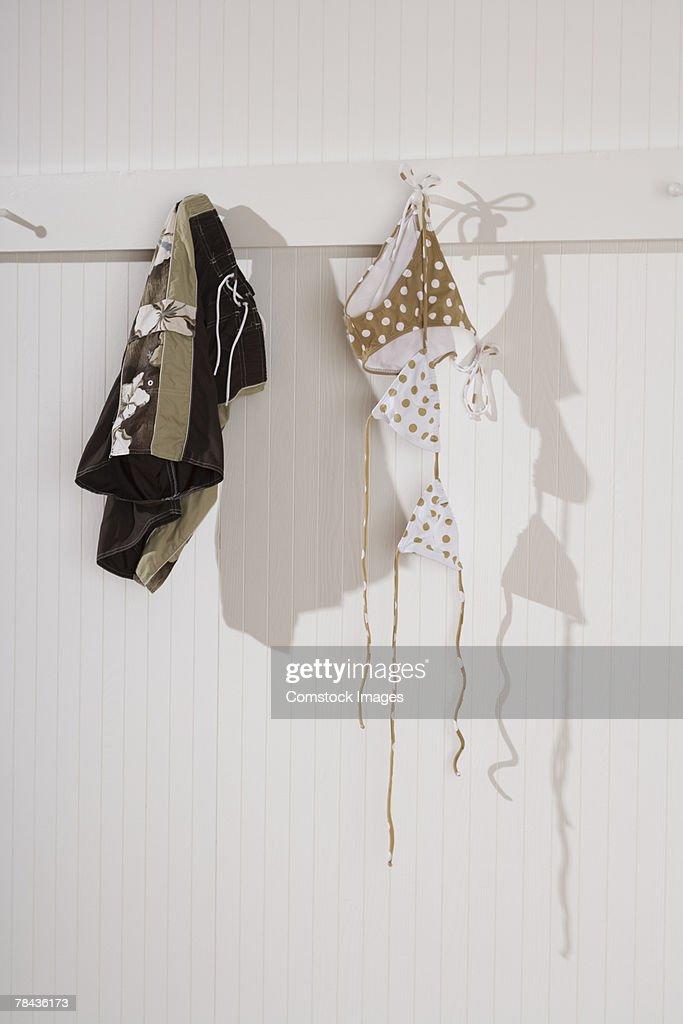 Swimsuit hanging on hooks : Stockfoto