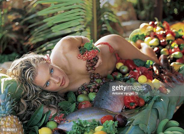 Model Rebecca Romijn poses for the 1999 Sports Illustrated swimsuit issue on February 1 1999 on Necker Island British Virgin Islands CREDIT MUST READ...