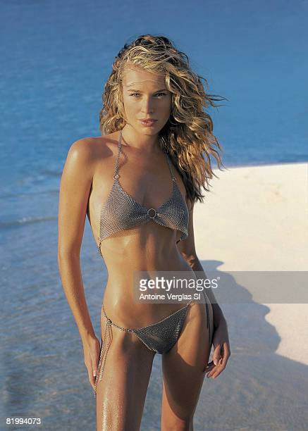 Model Rebecca Romijn poses for the 1999 Sports Illustrated swimsuit issue on February 1 1999 on Necker Island British Virgin Islands COVER IMAGE...