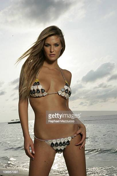 Portrait of Bar Refaeli on beach at The Caves Guitar pick bikini by Susan Holmes Swimwear Negril Jamaica CREDIT MUST READ Raphael Mazzucco/Sports...