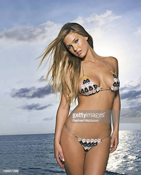 Portrait of Bar Refaeli on beach at The Caves Guitar pick bikini by Susan Holmes Swimwear Negril Jamaica PUBLISHED IMAGE CREDIT MUST READ Raphael...