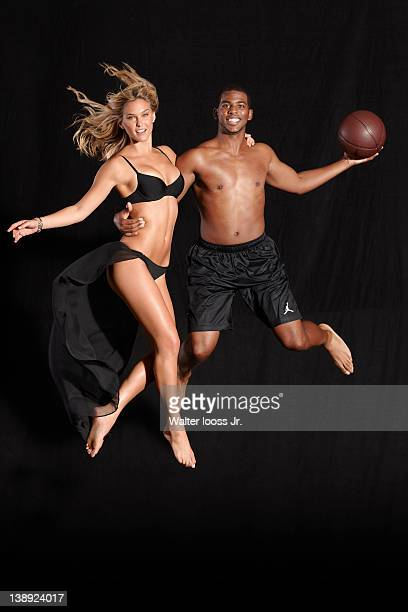 Swimsuit Issue 2012 Model Bar Refaeli poses with basketball player Chris Paul for the 2012 Sports Illustrated Swimsuit issue on October 3 2011 in New...