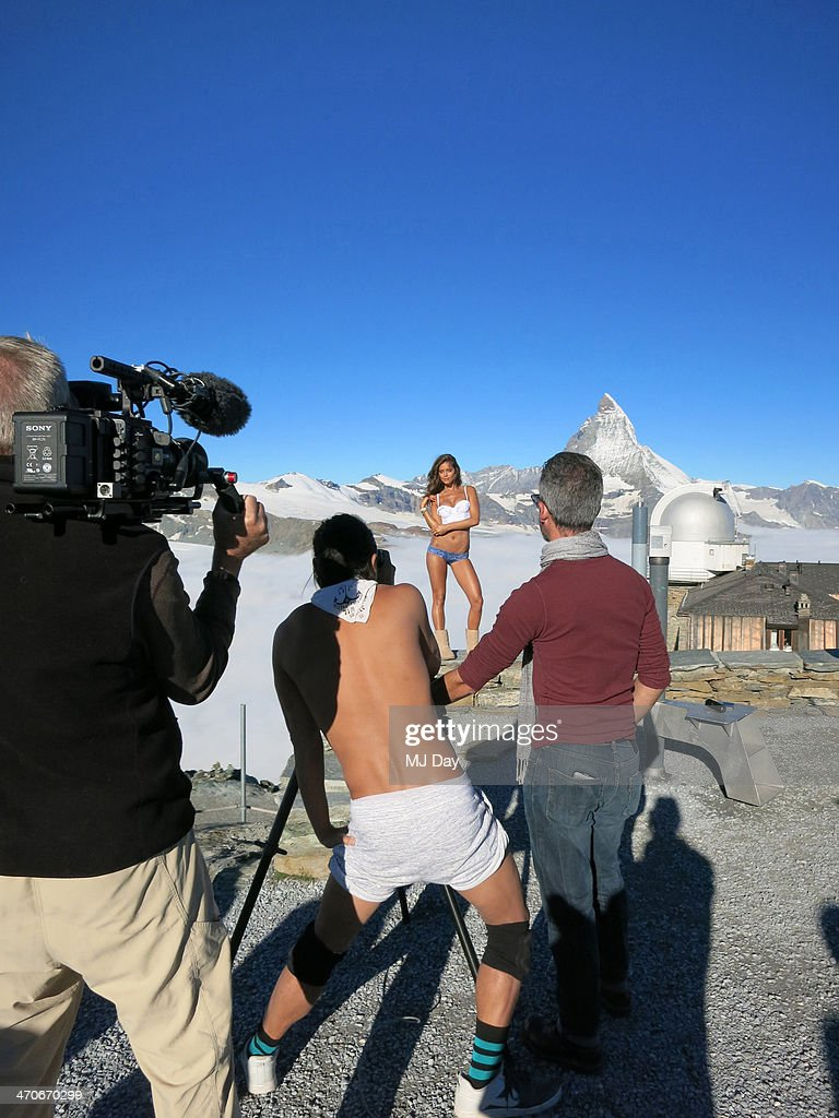 Behind the scenes of the 2014 Sports Illustrated Swimsuit issue are photographed on December 17, 2013 in Switzerland. Pictured: Model Emily DiDonato and photographer Yu Tsai.