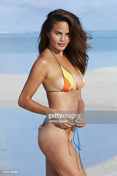 Swimsuit Issue 2014 Model Chrisine Teigen poses for the 2014 Sports Illustrated Swimsuit issue on November 5 2013 in Aitutaki Cook Islands PUBLISHED...