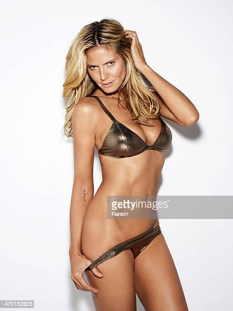 Swimsuit Issue 2014 Model Heidi Klum poses for the 2014 Sports Illustrated Swimsuit issue on September 19 2013 in Los Angeles California PUBLISHED...