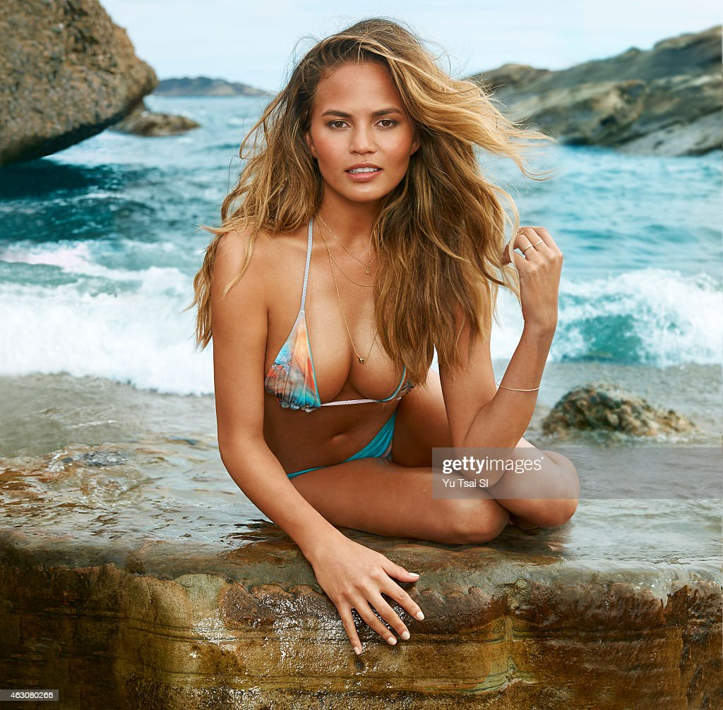 Model Chrissy Teigen poses for the 2015 Sports Illustrated Swimsuit issue on July 19, 2014 in the United States. Swimsuit by San Lorenzo Bikinis. PUBLISHED IMAGE.