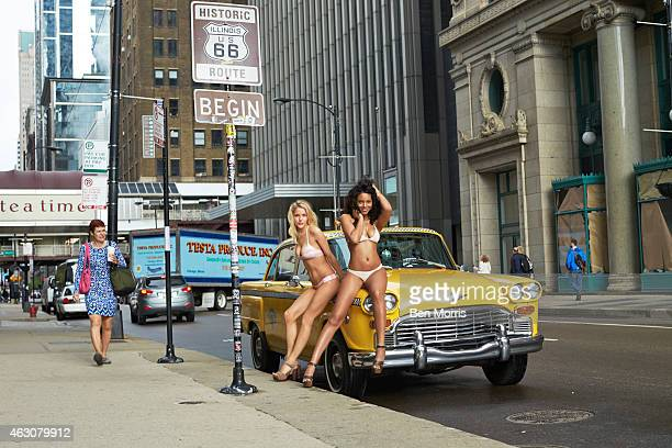 Swimsuit Issue 2015 Models Ariel Meredith and Ashley Smith pose for the 2015 Sports Illustrated Swimsuit issue on May 13 next to Route 66 Begin sign...