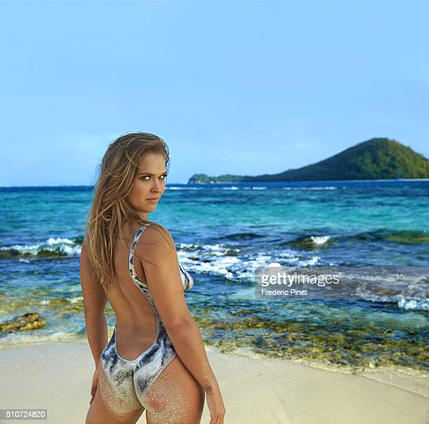 Mixed martial artist and actress Ronda Rousey poses for the 2016 Sports Illustrated swimsuit issue on January 5 2016 in Saint Vincent and The...
