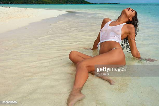 Model Irina Shayk poses for the 2016 Sports Illustrated swimsuit issue on August 22 2015 in BoraBora French Polynesia Bikini by Tori Praver Swimwear...